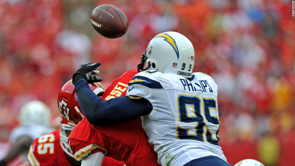 Shaun Phillips of the San Diego Chargers hits quarterback Matt Cassel of the Kansas City Chiefs, causing a fumble during the second quarter on Sunday.