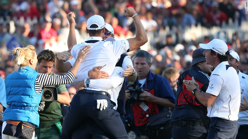 Martin Kaymer is mobbed by the European team after he made the winning putt on the 18th green on Sunday to cinch the Ryder Cup.