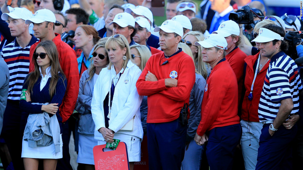Davis Love III waits with some of his team on Sunday at the end of the singles matches.