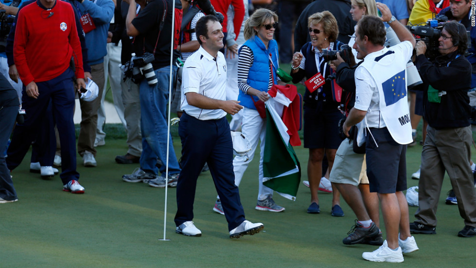 Europe's Francesco Molinari celebrates with his caddie, Jason Hempleman, on the 18th green Sunday after his match with Tiger Woods.