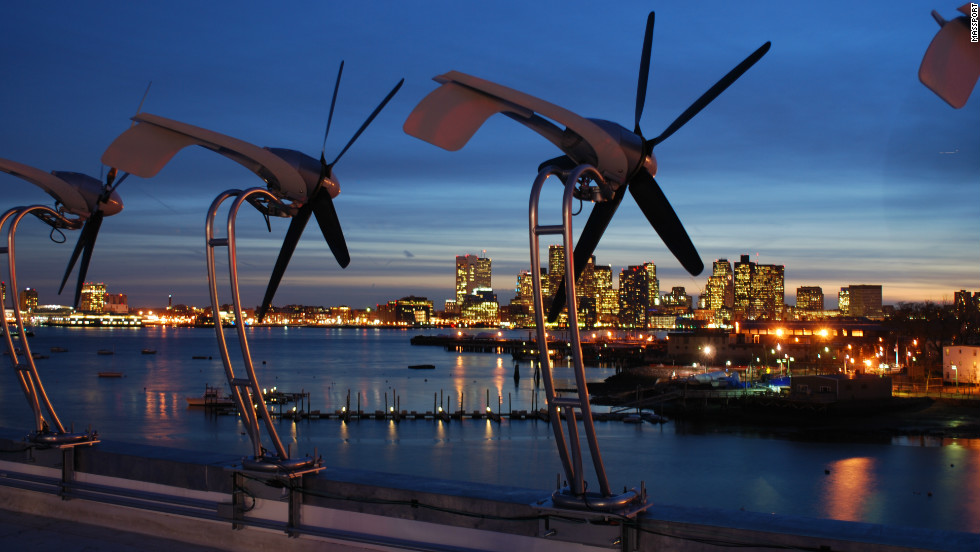 Wind turbines at Boston Logan International Airport look out upon the city's downtown area. A total of 20 wind turbines have been installed on the roof of the Logan Office Center.