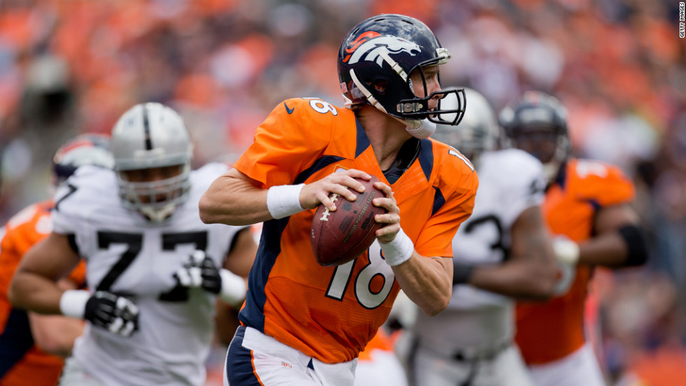 Quarterback Peyton Manning of the Denver Broncos looks to pass against the Oakland Raiders on Sunday.