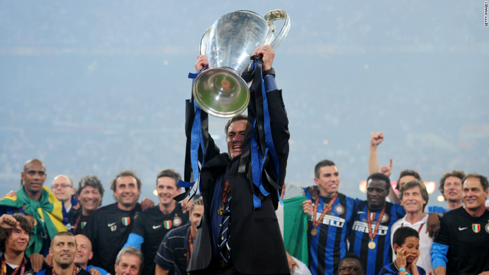Mourinho holds the Champions League trophy aloft at the Santiago Bernabeu following his side's 2-0 win over Bayern Munich. He became the third man in history to win the competition with two different clubs after Ernst Happel and Ottmar Hitzfeld.