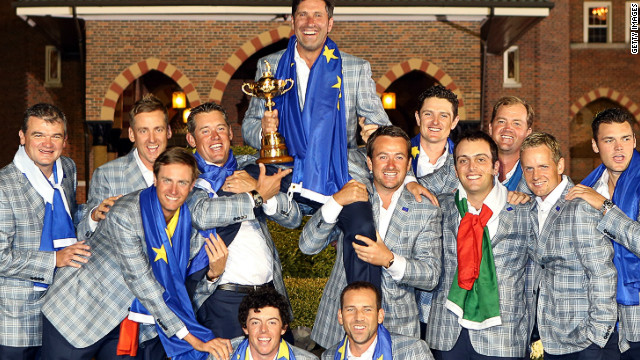 Europe's jubilant players lift their victorious Ryder Cup captain Jose Maria Olazabal in the air after winning in Chicago.