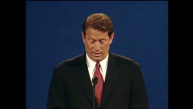 Al Gore sighs while Bush speaks
