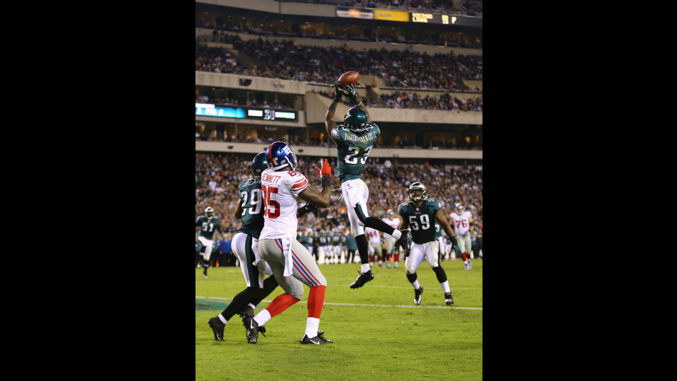 Dominique Rodgers-Cromartie of the Eagles intercepts a pass in the end zone thrown by Giants quarterback Eli Manning during Sunday's game.