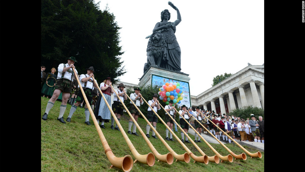 Alphorn musicians play at the foot of the Bavaria monument Sunday.