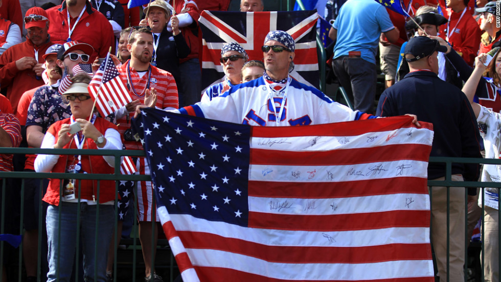 Fans watch the play on the first tee during the singles matches of the Ryder Cup on Sunday.
