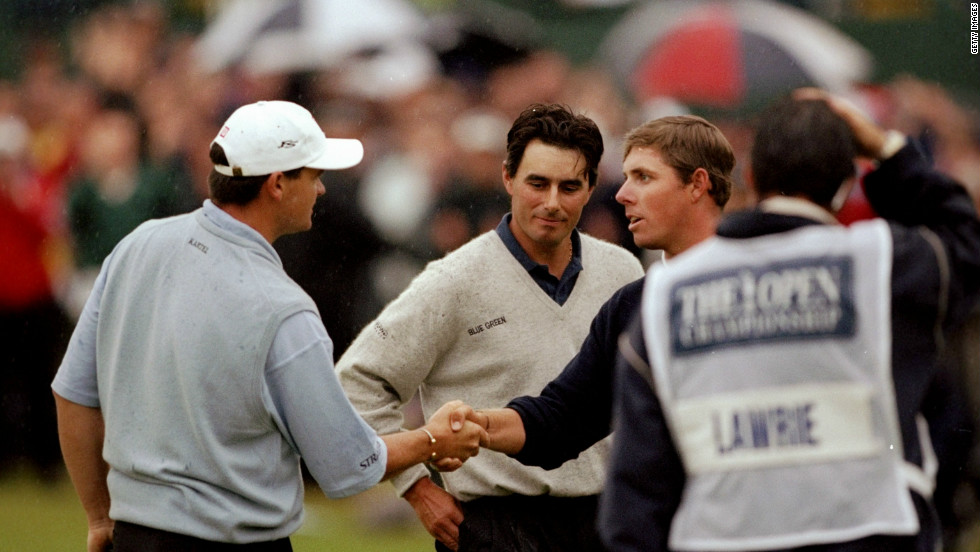 Jean Van de Velde (middle) looks bewildered as he reflects on his defeat in the 1999 British Open. The Frenchman blew a three-shot lead on the final hole, so forcing a play-off with Justin Leonard (right) and Scotland's Paul Lawrie (left) which the latter won to seal his first major, despite trailing Van de Velde by an enormous 10 strokes before the final round took place.