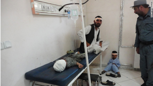 A suicide attack on a joint Afghan-NATO foot patrol killed at least 14 people early Monday.
