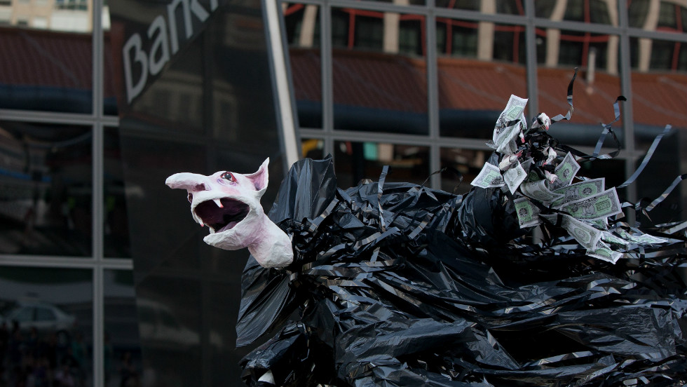 A vampire puppet holding money is held by protesters outside Bankia's building Kio Tower in Plaza Castilla, on June 2, 2012 in Madrid