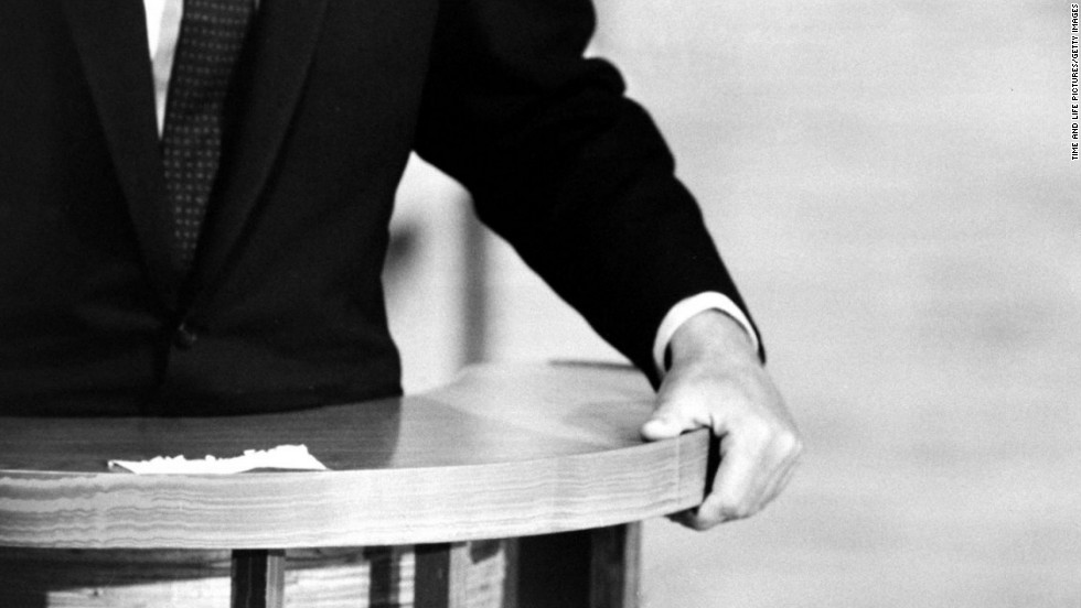 A closeup shows Kennedy's hand during the debates.