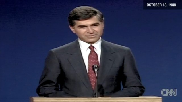 Michael Dukakis at a 1988 presidential debate. Vice President Bush used Dukakis' record against him, Julian Zelizer says.