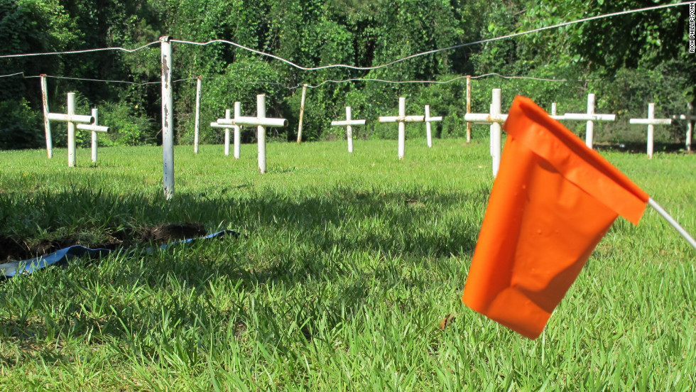 In 2012, forensic scientists sifted through 100-year-old paperwork to determine who is buried in this makeshift cemetery on the grounds of a former Florida reform school for boys.