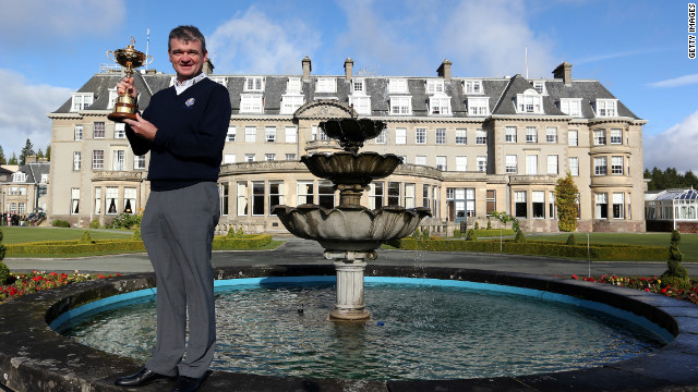 Paul Lawrie poses with the Ryder Cup in front of the Gleneagles Hotel in Scotland.