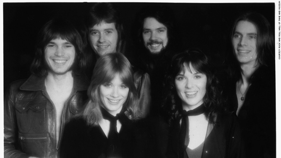 "Sisters Ann and Nancy Wilson were two of the first women to find fame fronting a hard rock band. The female rockers dominated the video music scene in the 1980s with hits like ""Alone,"" and ""What About Love."" Their band included guitarist Roger Fisher, bassist Steve Fossen, guitarist/keyboard player Howard Leese and drummer Michael DeRosier."