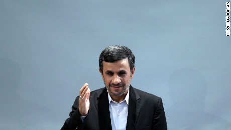 Iranian President Mahmoud Ahmadinejad waves during a press conference in Tehran on October 2, 2012. Photo credit: (ATTA KENARE/AFP/GettyImages)