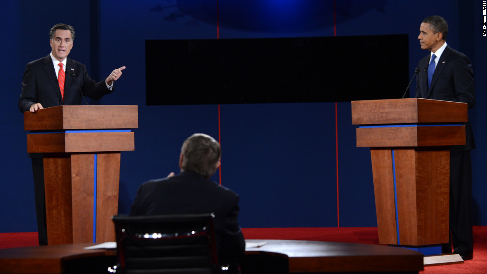 Romney answers a question from the moderator.