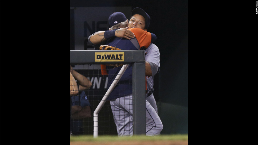 Cabrera hugs manager Jim Leyland as he leaves a game.