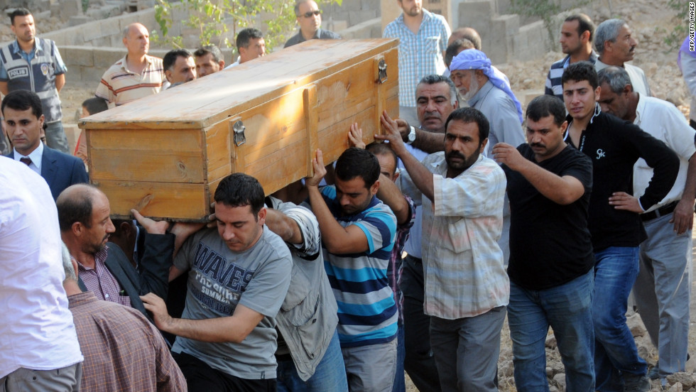 A victim's coffin is carried through town Thursday. Turkey hammered Syrian targets in reprisal for the cross-border fire that sent tensions soaring in the region, prompting international calls for restraint.