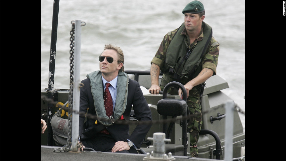 Daniel Craig greets a naval officer as he is unveiled as the new James Bond in October 2005.