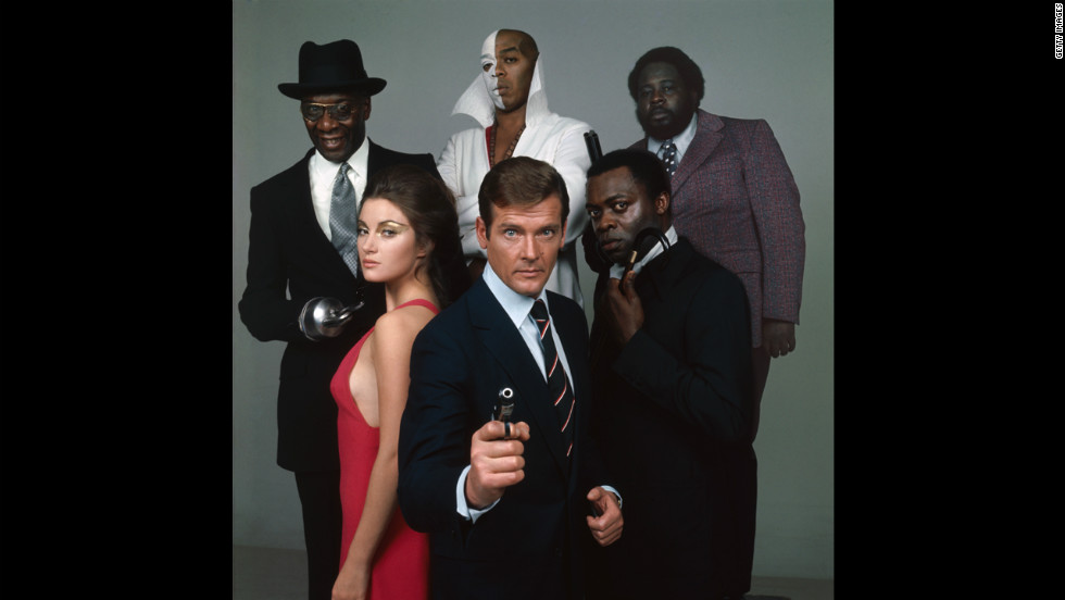 "The cast of ""Live and Let Die,"" in 1973, from front center, clockwise, Roger Moore as Bond, Jane Seymour as Solitaire, Julius Harris as Tee Hee, Geoffrey Holder as Baron Samedi, Earl Jolly Brown as Whisper and Yaphet Kotto as Kananga."