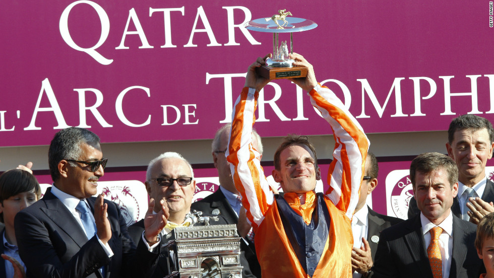 Jockey Andrasch Starke celebrates on the podium after German horse Danedream wins the 2011 race. The defending champion was banned from traveling this year after training at the Cologne racecourse, which is under strict quarantine following the detection of swamp fever.