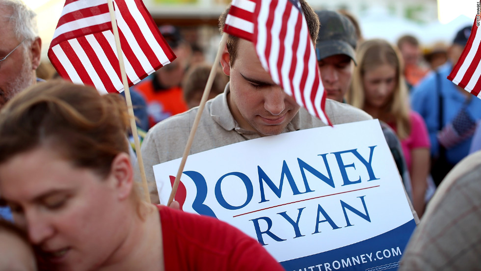 Romney supporters bow their heads in prayer during Thursday's event at the Augusta Expoland in Fishersville, Viriginia.