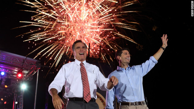 Mitt Romney (left) and his running mate, Paul Ryan, wave to supporters Thursday  in Fishersville, Virginia.