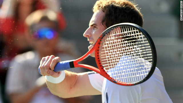 Andy Murray strikes a forehand during his three set win over Stanislas Wawrinka in Tokyo.