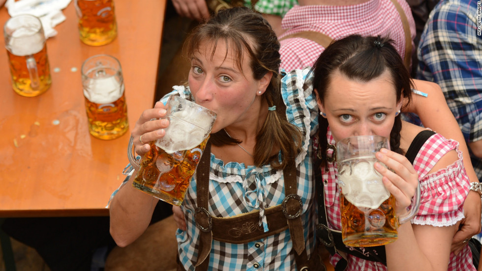 Oktoberfest visitors get into the spirit in a festival tent at the Theresienwiese on Friday.