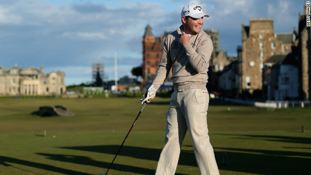 Branden Grace shares a joke before teeing off on the 18th at St Andrews which he birdied for a 67.