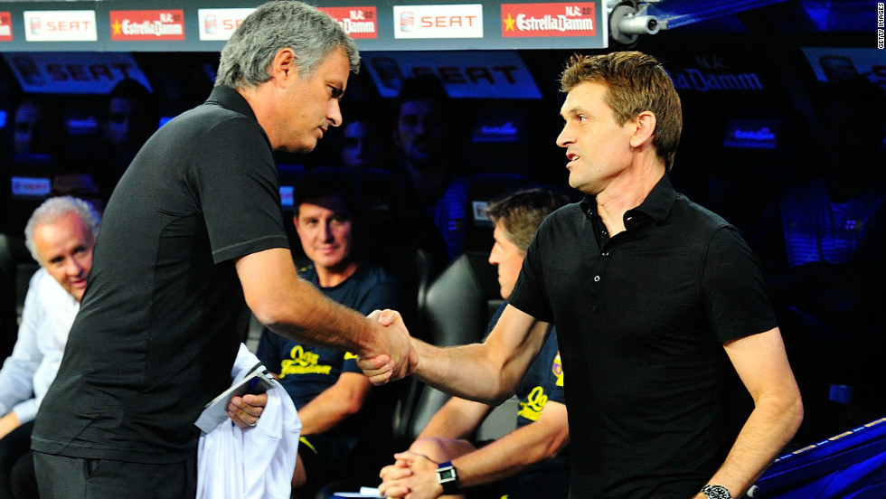 Real Madrid manager Jose Mourinho (left) and Barcelona manager Tito Vilanova (right) shake hands at the derby between the two clubs. Real's revenue is $695 million, $42 million more than Barca and $526 million more than that of Valencia.