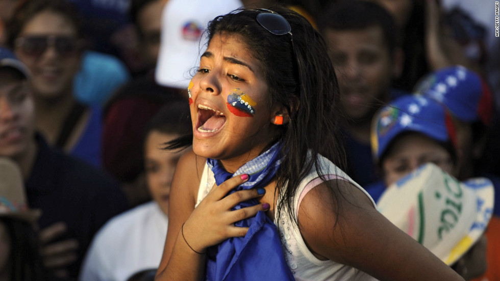A supporter of the opposition candidate, Capriles, screams during a campaign rally in Maracaibo.