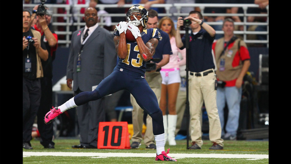 Chris Givens of the Rams catches a touchdown pass on Thursday against the Arizona Cardinals.