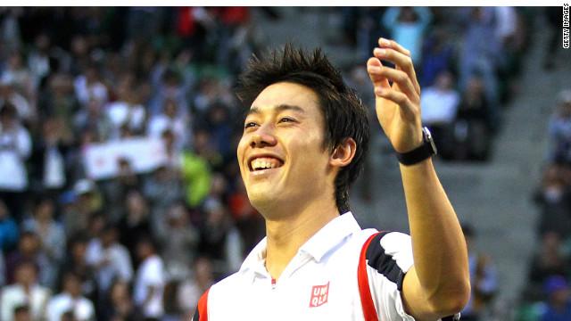 Kie Nishikori celebrates his hometown success in claiming the Japan Open in Tokyo.