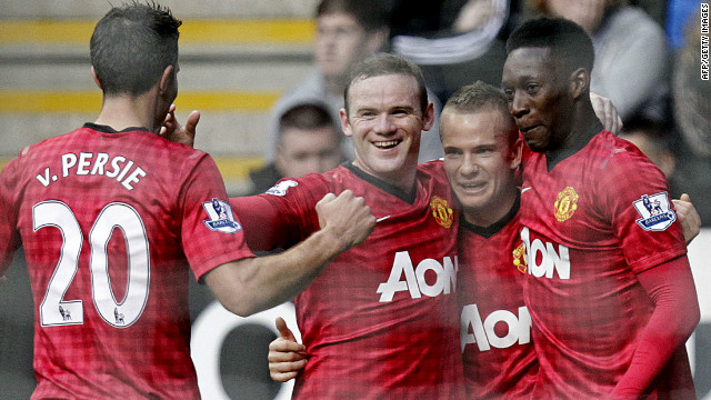 Manchester United players celebrate Tom Cleverley's superb goal in the 3-0 win at Newcastle.