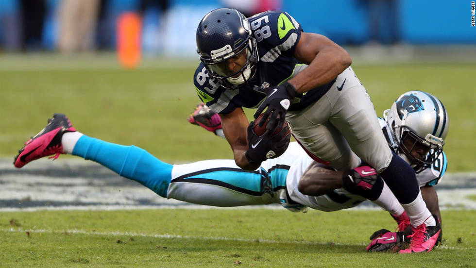 Sherrod Martin of the Panthers tackles Doug Baldwin of the Seahawks.