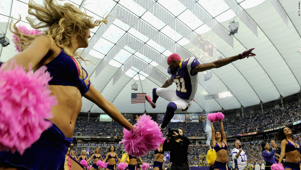 Jerome Simpson of the Minnesota Vikings jumps as he is announced before Sunday's game.