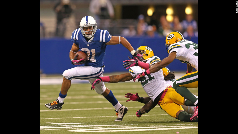 Donald Brown of the Colts breaks a tackle on Sunday.