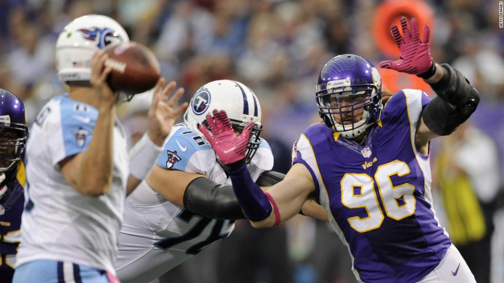 Brian Robison of the Minnesota Vikings puts pressure on Tennessee Titans quarterback Matt Hasselbeck on Sunday at the Hubert H. Humphrey Metrodome in Minneapolis.