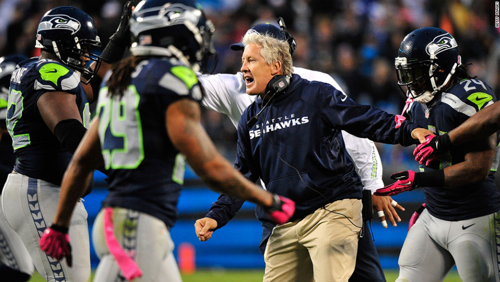 Seahawks coach Pete Carroll celebrates with his defense late in Sunday's game against the Panthers.