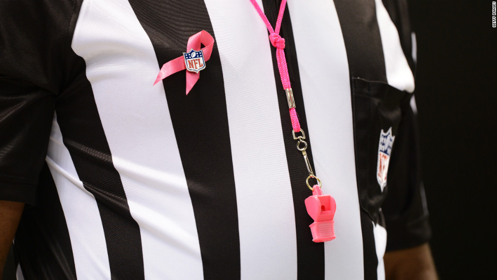 An official wears a pink ribbon and whistle for Sunday's game between the Chargers and the Saints. October is National Breast Cancer Awareness Month.