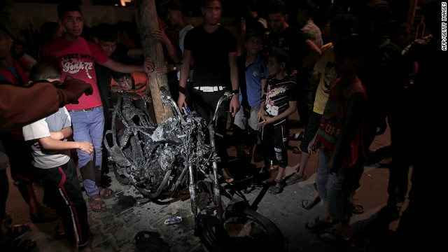 Palestinians gather around the wreckage of a motorcycle targeted by an Israeli aircraft in Rafah in southern Gaza on Sunday.
