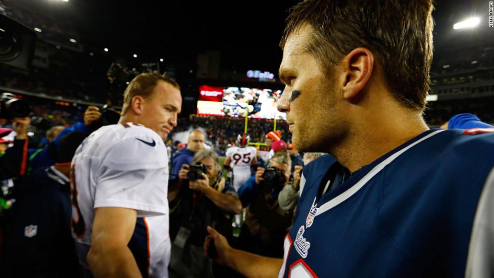 Patriots quarterback Tom Brady greets Broncos quarterback Peyton Manning midfield following Sunday's game.
