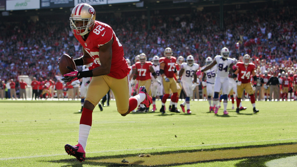 "Mario Manningham of the San Francisco 49ers pulls off a touchdown against the Buffalo Bills in the fourth quarter on Sunday at Candlestick Park in San Francisco. Check out the action so far from Week Five of the NFL, or <a href=""http://www/2012/09/27/worldsport/gallery/nfl-week-4/index.html"" target=""_blank""><strong>look back at the best from Week Four</a></strong>."