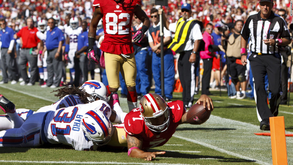 Quarterback Colin Kaepernick of the 49ers is stopped short of the goal line by Jairus Byrd of the Bills.