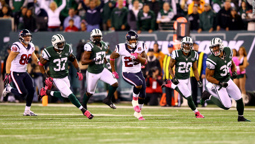 The Texans' Arian Foster runs the ball down the field in the first quarter.