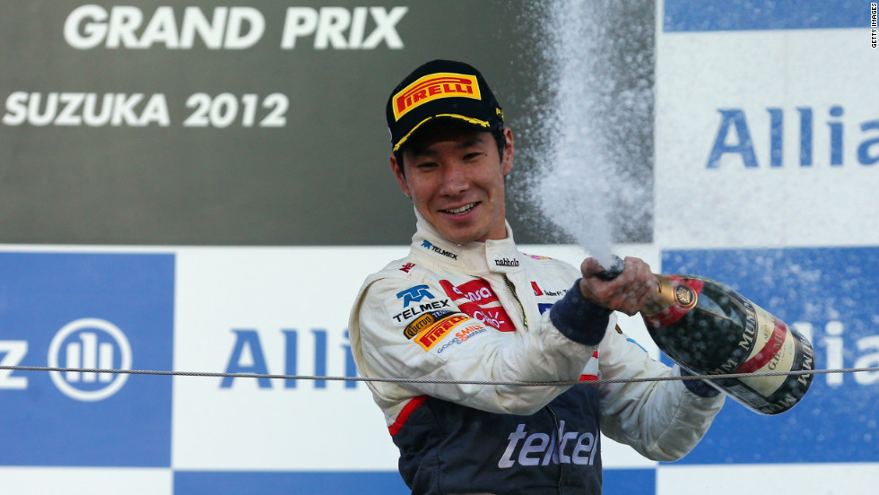 Kobayashi celebrates on the podium in front of ecstatic home support, who chant 'Kamui' in unison from the stands.
