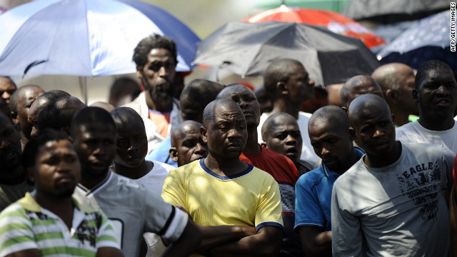 Striking mine workers gather outside the Anglo American Mine on Friday, October 5 in Rustenburg, South Africa.